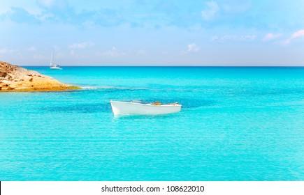 Es Calo de San Agusti with boat in Formentera island turquoise mediterranean