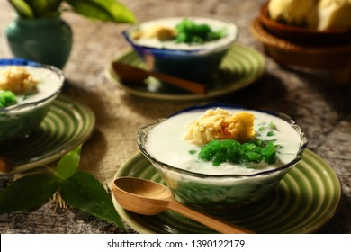 Es Cendol Durian / Es Dawet Duren. Peranakan icy dessert of pandan noodle jelly with durian, coconut milk and brown palm sugar.