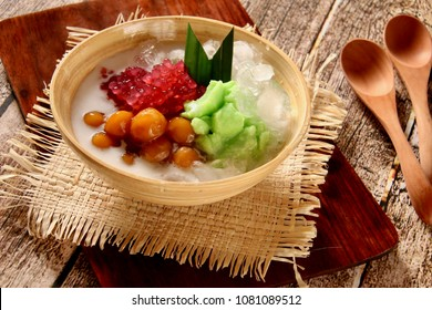 Es Loder or Es Sumsum. Traditional Sundanese dessert drink of rice and pandan custard pudding with sago pearls and glutinous rice balls in coconut milk.