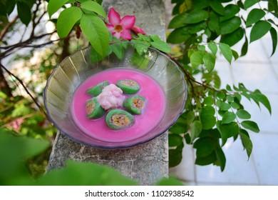 Es pisang ijo or green banana ice, traditonal Indonesian dessert made of banana wrapped in pandan rice flour dough. Popular during Ramadan for buka puasa