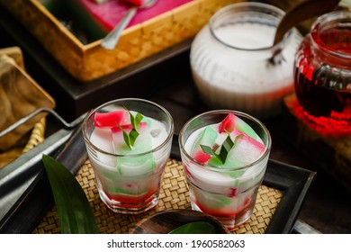 Es Selendang Mayang. Betawi's dessert drink of tricolour jelly cake in coconut milk and sweetened with sugar syrup.