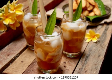 Es Tambring. Balinese cooling beverage of coconut and coconut water with palm sugar and tamarind.