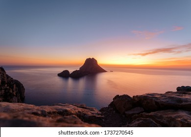 Es Vedra at the sunset, pastel colored sky at the mystic rock of Es Vedra, Ibiza Island.