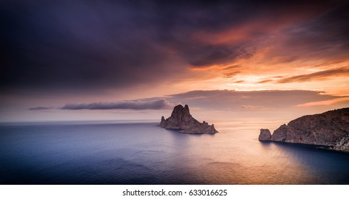 Es Vedra  Es Vedranell  islands at sunset with beautiful sky from Cala Llentrisca , Ibiza .