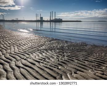 Esbjerg offshore oil harbor in silhouette on a sunny day, Denmark