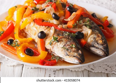 Escabeche fish: mackerel in vegetable marinade close-up on a plate on the table. horizontal