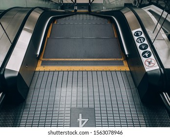 Escalator for the 4th floor of the mall with copy space. Escalator without passengers.