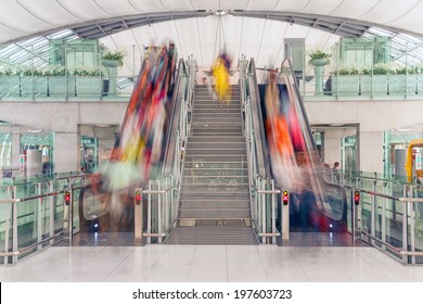 Escalator at the airport: passenger traffic, speed, transience. Canon 5D Mk II.