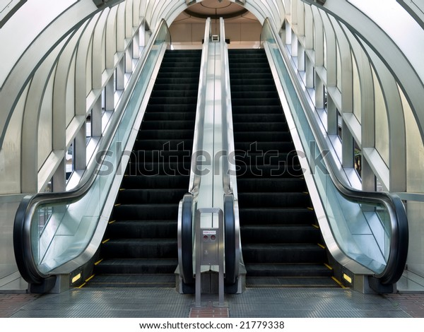 Escalator with an arched transparent glass roof