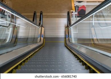 Escalator in Community Mall, Shopping Center or Department Store. Moving Staircase. Neon Light, Modern Escalator