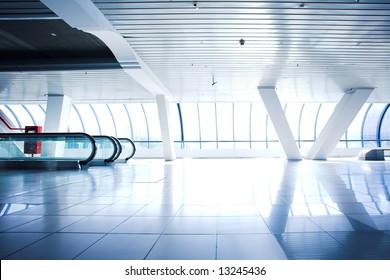Escalator in corridor in office centre