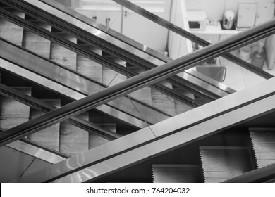 Escalator Up and Down Crossing Staircase in Shopping Mall or Airport concept of Modern Architecture Steel Structure Building and Abstract Artistic Interior Perspective Black and White Design