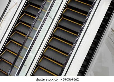 Escalator go up down in shopping mall