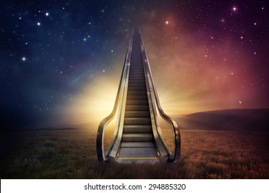 An escalator goes up to the night sky.