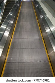 Escalator going up in shopping mall