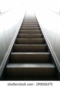 Escalator leading up to bright light, easy way to success, concept of successful, perspective