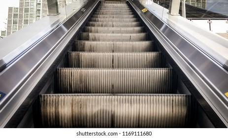 Escalator in metro. Moving up staircase escalator. Close up to Moving electric escalator.Close up floor platform electric escalator.