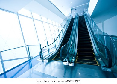 Escalator in modern office building.
