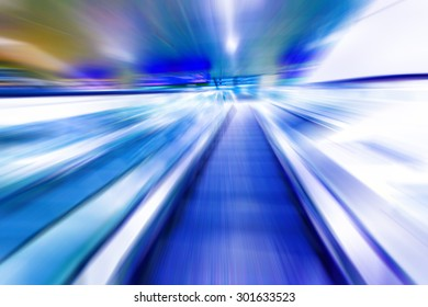 escalator on train station,  view in blue tone.motion blur