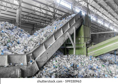 escalator with a pile of plastic bottles at the factory for processing and recycling. PET recycling plant