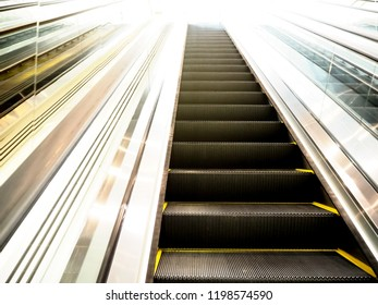 Escalator in shopping mall. Moving up and down staircase. electric escalator.