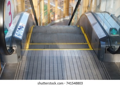 escalator in shopping mall moving downstairs