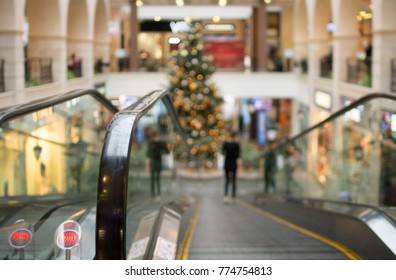 Escalator in shopping mall. Moving staircase background.