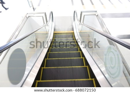 Moving Up Staircase. Escalator. Electric Escalator.Close Up