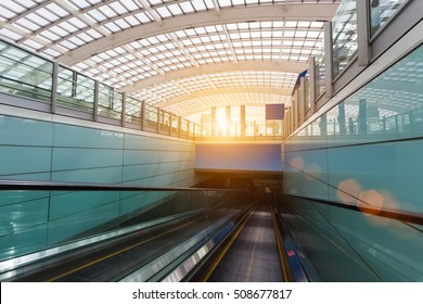 escalator within the terminal and roof of the transparent in modern airport