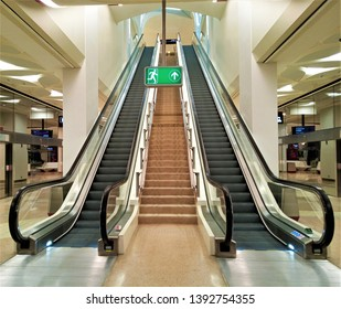 Escalators to Metro Platform at DECC Metro Stationin Doha, Qatar- 05/08/2019