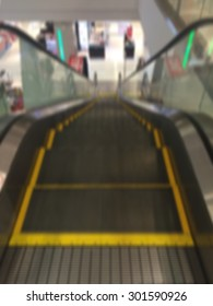 escalators at the modern shopping mall process in blurred