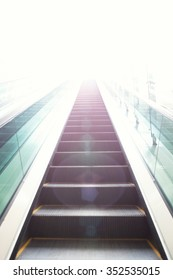 Escalators stairway as a concept of successful elevation