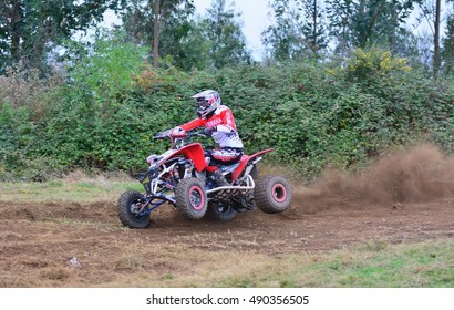 """ESCAMPLERO, SPAIN - SEPTEMBER 25: Unidentified racer rides a quad motorbike in the """"Promotion Quad Trophy Astur"""" on September 25, 2016 in Escamplero, Spain."""