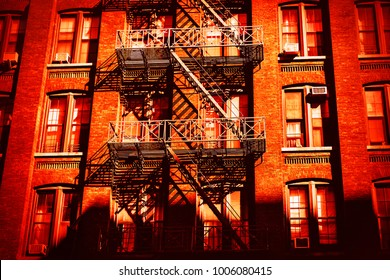 Escape fire ladders at house facades in Dumbo, Brooklyn, New York