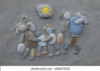 Escape from Syria, conceptual stones art over beach sand