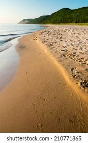 Esch Road beach, part of the Sleeping Bear Dunes National Lakeshore in Michigan, on a peaceful summer evening.