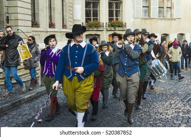 The Esclade festival in the old town of Geneva. Flutists wearing historical costumes march the streets. December, 2013