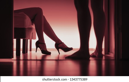 Escort, paid sex or prostitution. Sexy woman and man silhouette in bedroom. Rape or sexual harassment concept. Girl passed out on bed with high heels in party. Sugar daddy or customer with prostitute.