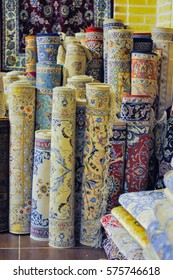 Esfahan, Iran - circa June 2011: Photo of carpet rolls in shop in Esfahan, Iran. Esfahan is one of centres for production of the famous Persian carpet. Documentary editorial.