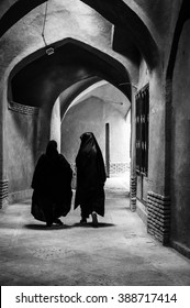Esfahan, Iran - February 2016 - Muslim woman with traditional chador on the street. Iran, 2016