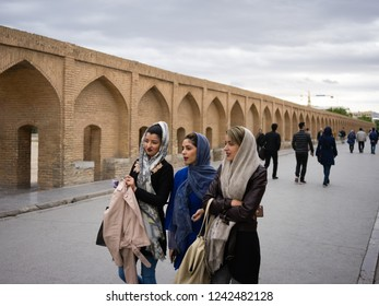 Esfahan, Iran - October, 2018: group of young fashionable Iranian muslim women a taking a walk on the bridge in Esfahan