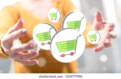 E-shopping concept between hands of a woman in background