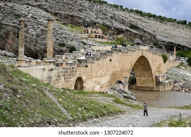 ESKIKALE, TURKEY — MAY 1, 2011. People visit the ancient Severan (Septimius Severus) Roman arched stone bridge over Cendere Creek near ancient Arsameia in Mount Nemrut National Park.