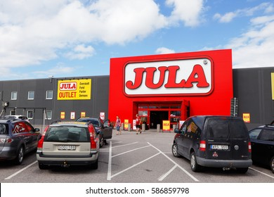 Eskilstuna, Sweden - August 5, 2016:Parking lot with cars parked in front of the building with the department store Jula at Folkesta west of Eskilstuna.