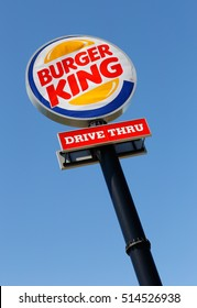 Eskilstuna, Sweden - June 14, 2014: Burger King Drive in road sign against blue sky  at the restaurant located at the Vasterleden. Photographed vertically and slightly diagonal.