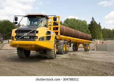 Eskilstuna, Sweden, June 25, 2015: Pipe carrier articulated dump truck Volvo , June 25, 2015, Volvo Days, Eskilstuna, Sweden