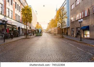 Eskilstuna, Sweden - Oct 20, 2017: Drottninggatan street in Eskilstuna with local bus a late autumn day