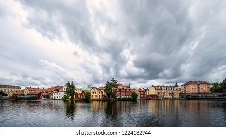 Eskilstuna, Sweden, with the old city architecture skyline with dark heavy clouds day.