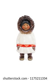 Eskimos. A common souvenir from Alaska : a ceramic miniature of the Eskimos girl for a shelf display, interior decoration. Eskimo girl isolated on a white background
