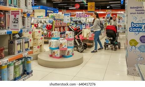Eskisehir, Turkey - April 08, 2017:  Female customers with baby stroller shopping in baby shop store in Eskisehir, Turkey